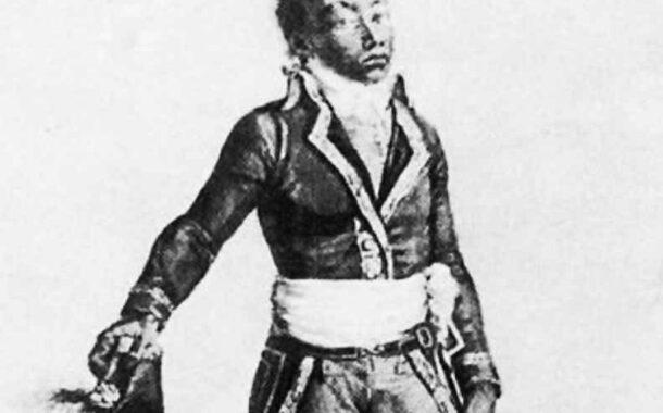 """Туссен Лувертюр родился рабом (1743–1803) в жилище Бреда в Haut du Cap Français во французской части Сен-Доминго (ныне Республика Гаити): в этой области находится собственность графа Ноя, Туссен занимает функции доверия - кучер и конюх - и пользуется защитой человека, который управляет плантацией в отсутствие владельца """"Байон де Либертат"""""""